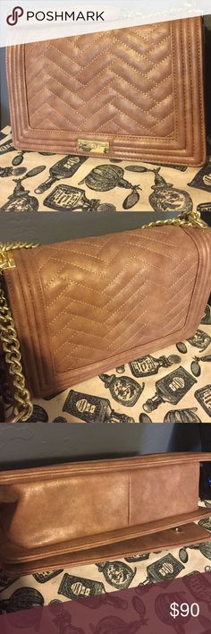 """BCBG BCBG shoulder bag Le Boy style Color: Coffee with gold details classic quilted handbag Adjustable gold chain and fabric shoulder strap One interior large zippered pocket, 2 slip pocket with matching lining Magnetic closures 11""""W x 3.5""""W x 8""""H **(used for one night)** BCBG Bags Shoulder Bags"""