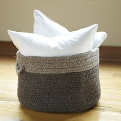 Minter Wool Basket, Chocolate   This oversized, square-shaped basket is perfect for organizing any room of the house. Crafted entirely of wool, side handles make for easy carrying.