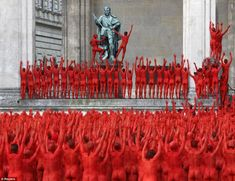 The red sea of people: Hundreds of naked volunteers are spraypainted by US artist for interpretation of Wagner opera