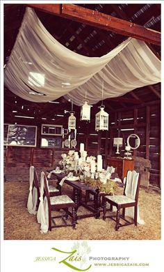 Rustic Barn Wedding Reception Space with Draped Fabric Decor Ideas vintage barn wedding decor with suspended hurricane lanterns vintage barn wedding decor with suspended hurricane lanterns Hay Wedding, Woodland Wedding, Rustic Wedding, Wedding Reception, Wedding Ideas, Wedding Table, Lantern Wedding, Wedding Photos, Wedding Planning
