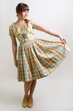 50s dress from zwzzy.  Mom may have had this dress. Or one made with the same fabric.