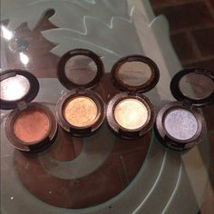 4 MAC eyeshadows These colors are gorgeous! Great for blending and creating a beautiful, finished, professional look. Some used more than others but there is still a substantial amount in all. One shadow has a small crack as seen in picture but still a lot left! Purchase comes with all 4 items as seen in picture! MAC Cosmetics Makeup Eyeshadow