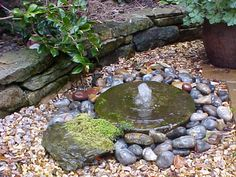 Bubble fountain with mill stone
