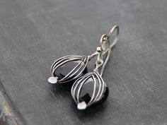 Herring bone wrapped flat coin faceted black onyx and sterling silver dangle earrings, classy, black and white, wire wrapped, teardrop by Keepandcherish on Etsy