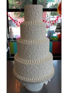 4 tiers, white buttercream, filigree scroll