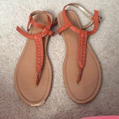 Orange sandals In good condition, damage on the toe of the right shoe (see pic). Black Poppy Shoes Sandals