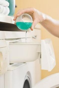 Use high-efficiency cleaning products in your HE front loader washer when cleaning the shower liner.