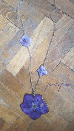 This is a unique necklace made of epoxy resin and a real flower- purple hydrangea. The lenght of the necklace can be regulated according to your taste. The pendants are very lightweight. They also look fragile but are unbreakable. In order to preserve the bright colors of your jewelry, it should not be stored in sunlight for longer time (weeks or years) to prevent the colours from fading. Keep it in a box( or not in direct sunlight) when you are not wearing it. Walk with me in a beautiful…