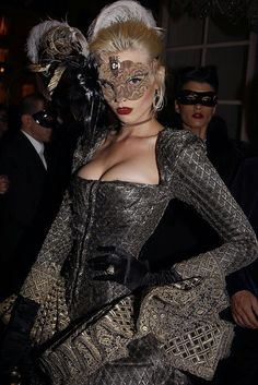 Masquerade ball gown & mask. She hides her shyness under her mask, finally releasing the boldness to blazen her busoms.