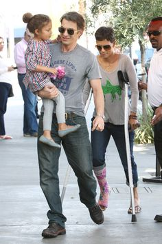 Caught on crutches! Halle Berry shows off her pink cast