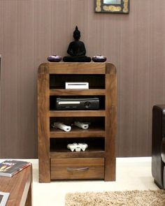 This storage unit represents a fabulous-looking, yet functional storage solution for your DVD player, Skybox and other devices when a standard television cabinet just doesn't make sense in your living space. The unit incorporates a handy dovetail-jointed drawer at the bottom, ideal for storing remote controls and random gadgetry, games controllers, etc. Only £279