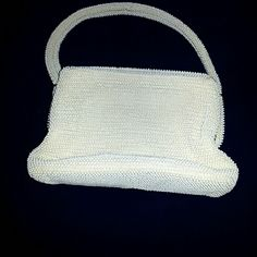 Vintage white beaded handmade. Exquisite Beaded white bag. Appears to be from the 60's.  Cannot completely read the brand bame on the inside of the purse with a matching white lining. There is a gold trim edge  Some of the gold trim has turned silver. This is a beautiful piece! Comes from a pet and smoke free home. Please ask any questions you may have before you buy.  Thanks! Bags Mini Bags