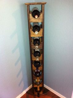 CustomMade by Heather Aldridge: Maximize your wine inventory while minimizing space.Solid wood, tall, skinny wine rack designed to effieciently fit into a corner with a capacity to hold 8 bottles of your favorite wine.5 1/2' X 6 1/2