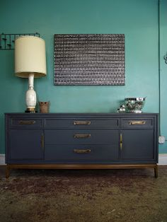 love love love the dark, muted grey-blue with the wood. mid century dresser.