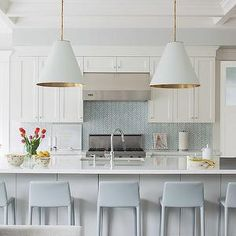 gray and white.  pendants, stools, backsplash.