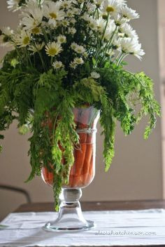 Carrots aren't just finger food — place the veggies in a clear vase along with white flowers for an extra pop of color on the Easter table.