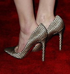 """Amber Heard wearing gold dotted Christian Louboutin pumps at the """"3 Days to Kill"""" Premiere 