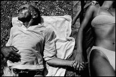 GREECE. Dodecanese islands. Leros. Leros beach. A patient and a care worker lie in the sun. 1994. Alex Majoli. I think the juxtaposition in this image is beautiful. The way that the withered old man is holding a clearly healthy, youthful woman's hand is very touching. I will attempt to use a element of juxtaposition in my photography