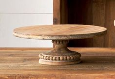 Farmhouse chic and rustic wooden cake stand. Measures 4.5 inches tall and 12 inches across. Make a statement with this piece at your next get-together.