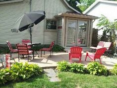 Patio Mister For Backyard Refreshing And Cooler In Summer Days With Red Chairs ~ http://lovelybuilding.com/adding-patio-mister-for-backyard/
