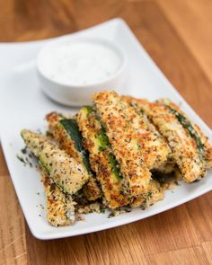 INGREDIENTS2 zucchinis1 cup panko½ cup grated parmesan1 tablespoon garlic powder1 tablespoon dried basil1 teaspoon salt1 teaspoon pepper2 eggsPREPARATION1. Preheat oven to 425°F/220°C.2. Cut zucchini into fries and set aside.3. In a large bowl combine panko, parmesan, garlic powder, basil, salt, and pepper.4. Whisk eggs in a shallow bowl or dish. 5. Dip zucchini in eggs, coating evenly, and then toss in bread crumb mixture. 6. Place on a baking sheet lined with parchment paper. Bake for…