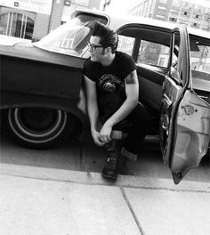 note the pomp, the cuffed jeans, and boots. definite greaser :)