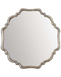 You'll be enchanted by this shapely mirror. Features a plated, oxidized silver finish frame, and a rust-gray wash. Stunning in a bath or entry. Designer: Grace Feyock Dimensions: 33 W X 33 H X 2 D (in