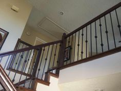 In this Houston home, we took out the existing balusters and put in our new powder coated wrought iron pieces.  The new balusters, our PC49/1, PC49/2, and PC28/5, all in our Old World Copper color, give the staircase profile with clear style that the original wood balusters just couldn't hope to match.