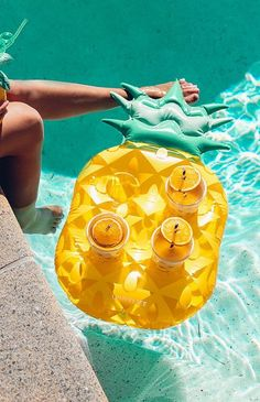 Add instant tropical vibes to your pool with this Pineapple Drink Holder Float! Size: holds four drinks Add some fun to your next pool party with this fun inflatable Pineapple drink holder!