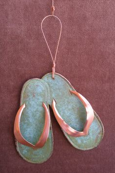 Hey, I found this really awesome Etsy listing at http://www.etsy.com/listing/108147713/flip-flops-copper-verdigris-ornament