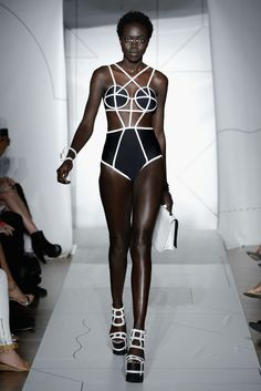 Chromat S/S 2015: Empowered Fashion of the Future - Graphic linear elements make this swimsuit very futuristic looking.