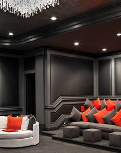 @heidini home theater. I'm in love with the dark colors and added pop of color.
