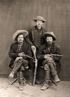 The outlaw cowboys in this photo are not identified, but some historians believe the man standing is outlaw chief John Kinney, who led a gang of horse thieves and cattle rustlers during the 1870s-80s, all while running his own ranch just west of the Rio Grande.