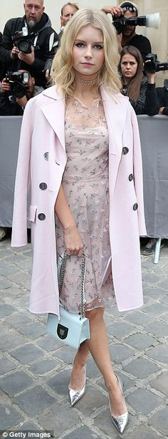 'It' Brits: Lottie Moss, 18, wore a coat and dress in the same pale blush shade to the Chr...