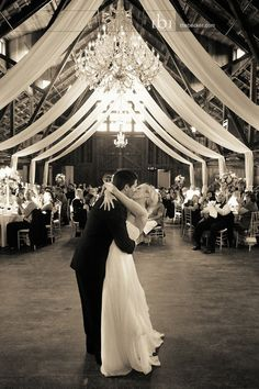 Love chandeliers in a rustic venue