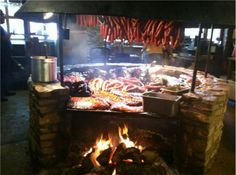 The Salt Lick in Driftwood is well known for its historic ambiance. It features one of Texas' most photographed BBQ pits, outdoor and indoor family-style seating spaces and a flexible B.Y.O.B. option.