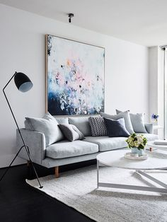 living room pale grey sofa scatter cushions pastel painting artwork black reading - White Sitting Room Furniture
