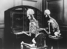 22x18 (58x48cm) Framed Print featuring A pair of skeleton pianists play a macabre duet, circa 1950. (Photo by FPG/Hulton Archive/Getty Images).