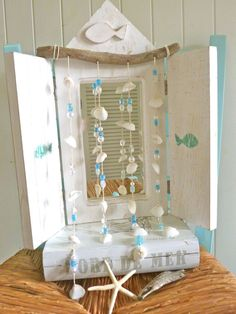 beautiful mobile made with driftwood i found on a sydney harbour beach, small white clam shells and some of my favourite clear, pearly &