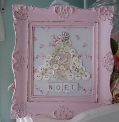 Beautiful! Use vintage jewelry and buttons to make a Christmas tree on a floral fabric background with a vintage frame! Love the pink!