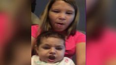 Baby Spits Up While Doing a Face Swap With Older Sister