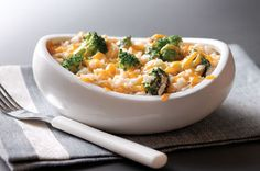 Q: How do you make broccoli cheese rice ridiculously creamy? A: Add butter, cream of mushroom soup and evaporated milk. And don't forget the cheddar!