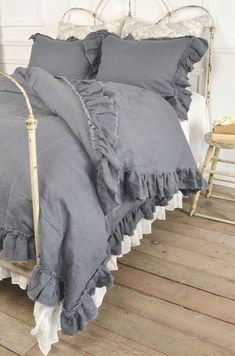 Vintage Ruffle Duvet Cover from Full Bloom Cottage. Love the comforter set. I would leave the bed frame. #Duvets