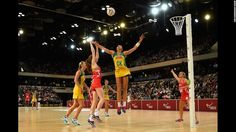 England's Helen Housby shoots over Australia's Sharni Layton during a netball game in London on Friday, January 22. Australia swept the three-game series.  Red Dust Active - Functional. Fun. Stylish - active accessories made for active liefstyles - www.reddustactive.com