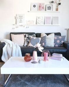 A beautiful DIY gallery wall with ikea picture ledges. Beautiful grey and pink tones throughout. I'd probably change the sofa to a nice grey fabric. I like the amount of design/art work on display and the interior accessories are cute too