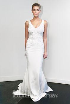 A V-neck #weddingdress by @nicolemillernyc  | Brides.com