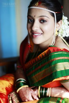 Indian Maharashtrian bride wearing traditional bridal saree and jewellery