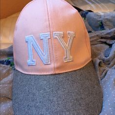 Cotton On Pink & grey Baseball Hat :) Cotton On Pink & grey Baseball Hat! Has a little stain but I can wash for you and it'll come off I promise. Super cute fits any head. Never worn just dropped. No tags :( Cotton On Jackets & Coats