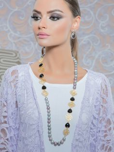 Beautiful Grey fresh water pearl necklace with black onyx and 24k gold filigree work. Shop now.