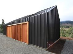 Corrugated metal with clear finished wood accents